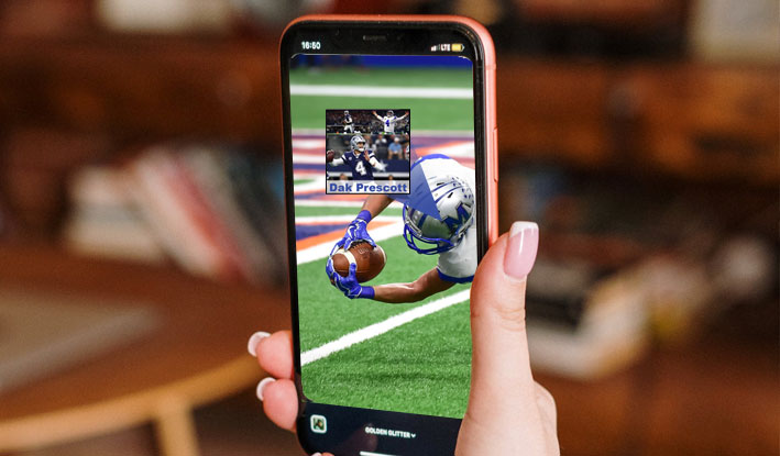 User watches TV and has a Fantasy Football app on their phone.